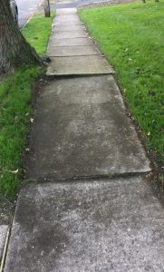broken concrete sidewalk